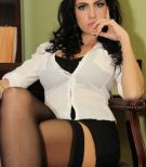 Glasses wearing brunette Emmanuelle London flashing upskirt thigh in nylons
