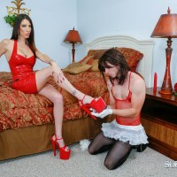 Clothed female Dava Foxx force crossdressing sub to lick feet and clean house