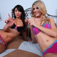 Bikini clad bad girls Amanda and Esmi Lee torture male slave with CBT treatment