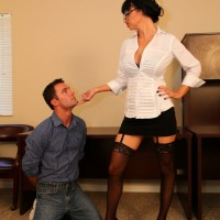 Stocking and high heel clad Domme Angie Noir using crop to control sissy boy