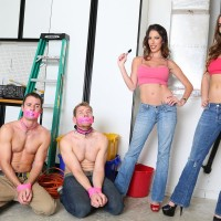Clothed babes Dava and Molly dominate collared sissy dudes in heels and denim jeans
