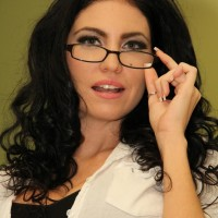 Glasses outfitted dark haired Emmanuelle London demonstrating clean-shaven upskirt fuckbox in nylons
