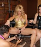 Kimber Woods and a beautiful female piss into a cup that is held by a collared male sub