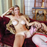 Sissy maid in lingerie sucks toes of busty blonde domme Alexis Fawx