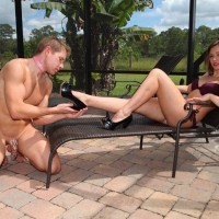 Sexy wife Callie Calypso having barefeet worshiped by bound male slave