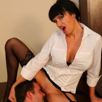 Stocking and glasses clad mistress Angie Noir having licked by submissive man
