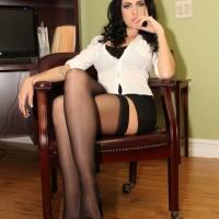 Glasses wearing brunette Emmanuelle London flashing upskirt thigh in nylons