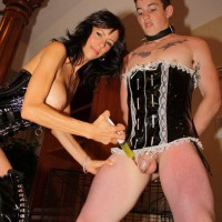 Busty brunette wife Alexis Faux dominating submissive man in French maid outfit