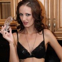 Mature Domme Hailey Young poses in black stockings and panties for subby hubby