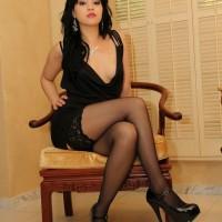 Cruel bitch Chloe Cain posing in pantyhose and high heels after sending sub away