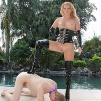 Hot blonde mistress in thigh high boots Ashley Edmunds leads male sex slave