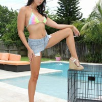 Adriana Lily lets collared submissive free from cage outdoors by pool for pegging