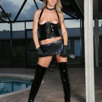 Light-haired chick Alina Lengthy demonstrates her small tits in a spandex microskirt and hip high boots