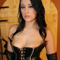 Brunette Bossy type Ashley posing about basement partly naked in fetish outfit
