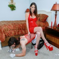 Clothed brunette Wife Dava Foxx instructing crossdressing sissy maid with lash