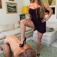 Clothed girlfriend Holly Halston makes her submissive eat her ass and vagina