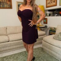 Mistress Holly Halston hikes her dress and makes her sub slurp her butt and honeypot