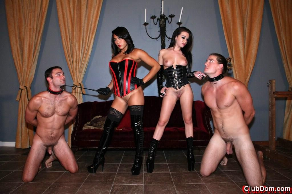 Hot brunettes in corsets, boots and gloves discipline submissive males