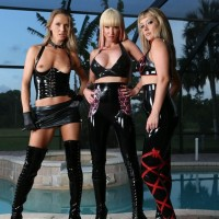 3 hot blondes in latex attire and high heeled footwear put a male sub on knees