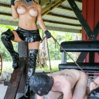 Busty blonde Domme Alexis Fawx leads two hooded male subs on a leash