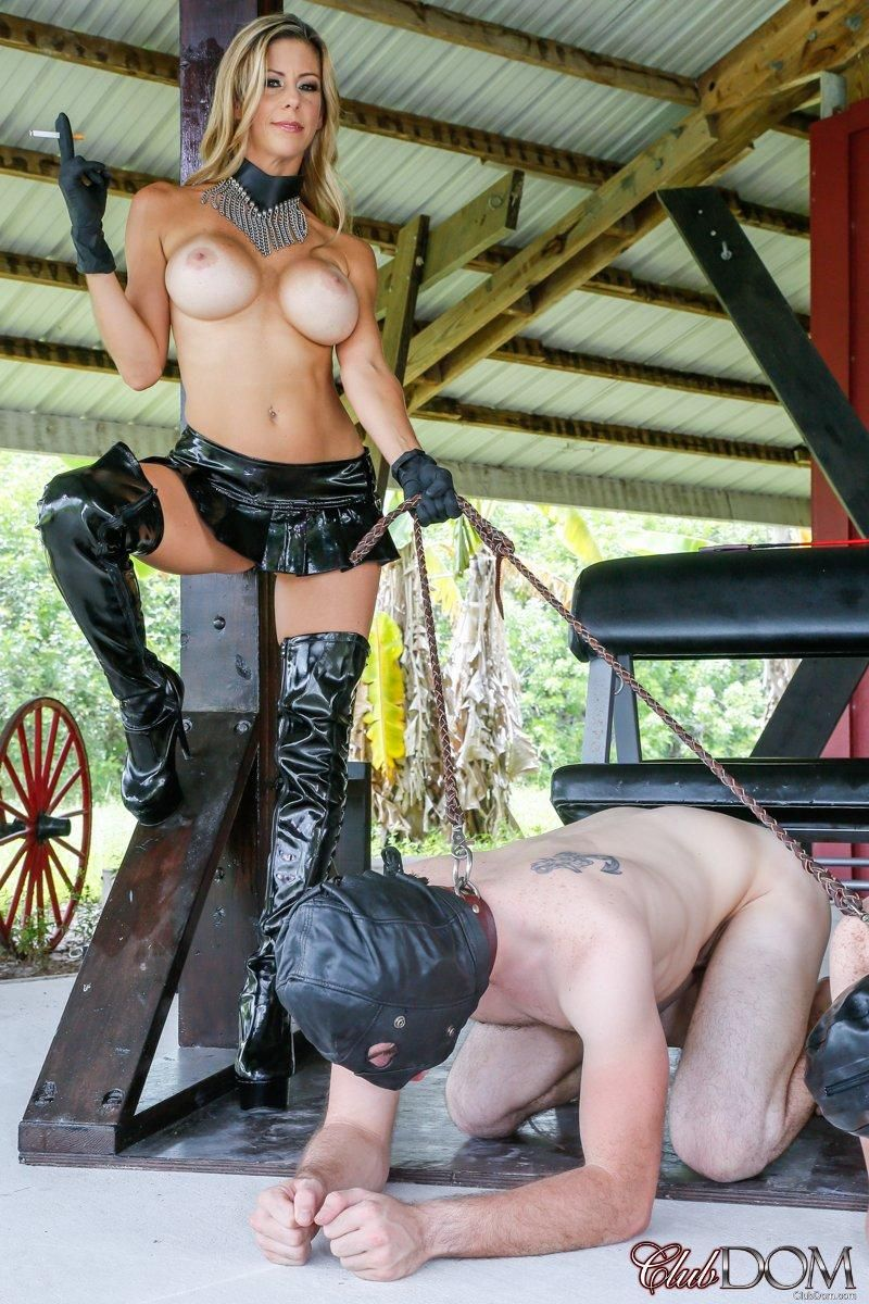 Busty blonde Alexis Fawx forces hooded male slaves to their knees in OTK boots