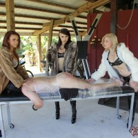 Isobel Raven and a couple of cruel bitches strapon fuck a restrained male sub