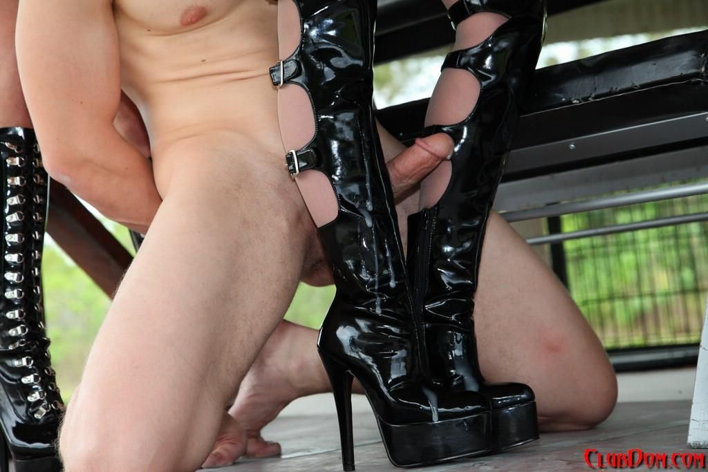 Hot females torture a naked male sub with electricity while clothed in latex and boots