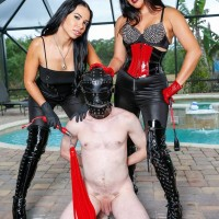 Kylie Rogue from Club Dom tops a male sub with the help of a hot girlfriend
