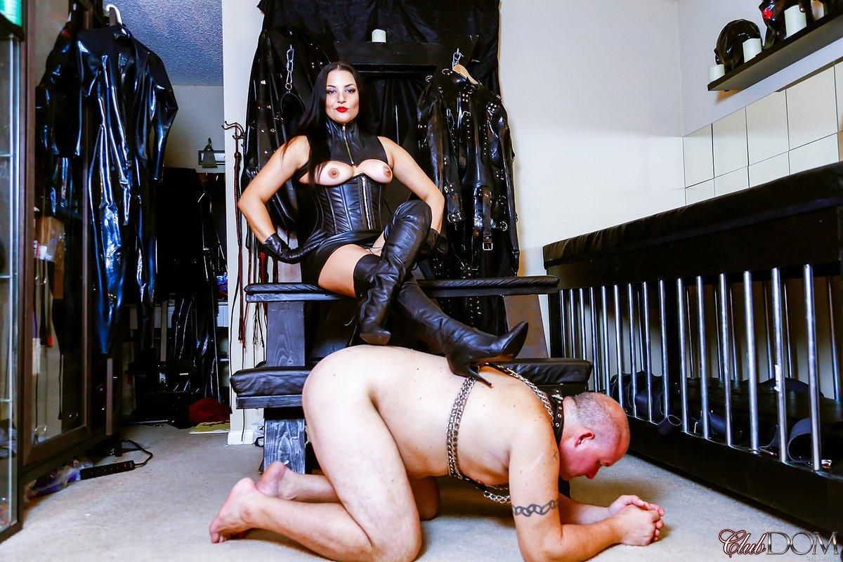Dark haired Domme Michelle Lacy rides her male slave like a dog in leather attire