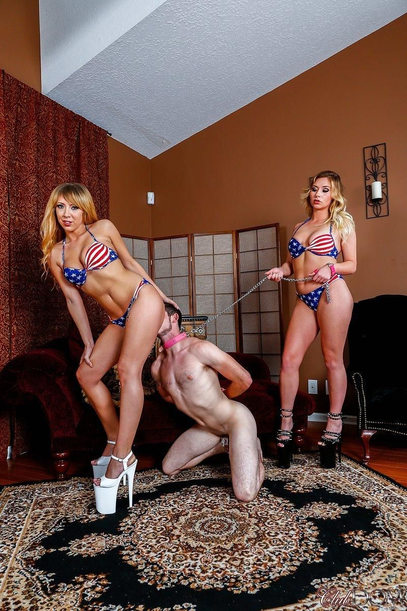 Hot blondes in USA themed bikinis torment a collared male sub