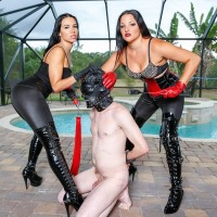 Brown-haired females Kylie Rogue and Michelle Lacy dominate a hooded male slave