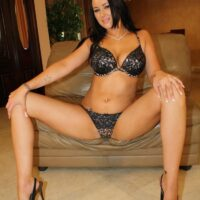 Dark-haired MILF Ashley showing her ultra-cute breasts while having a ciggy