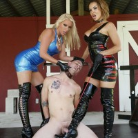 Dressed dommes Kylie Rogue and Virgin Morgan dominate a naked and collared sub
