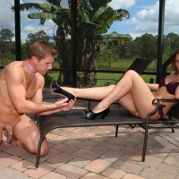 High heel and swimsuit clad gf wife Callie Calypso receiving foot idolization from submissive