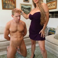 High heel garmented domme Holly Halston has her collared sissy eat out her cunt