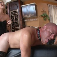 Seductive fair-haired wife Ashley Edmunds makes her slave spouse blow her strapon penis
