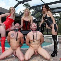 Hot females in latex attire and thigh high boots abuse collared male slaves by a pool