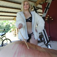 Isobel Raven and girlfriends abase and lash a confined male slave on a bondage table