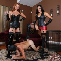Michelle Lacy and a tempting chick dominate a hooded male in latex and lengthy boots