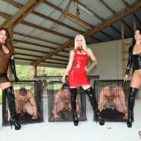 Domme Brianna and a 2 other fully clothed dommes put male submissives away in cages
