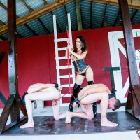 Seductive dark-haired Dominant Dava FoXX abusing and humiliating TWO masculine submissives