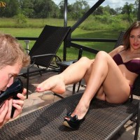 Seductive wife Callie Calypso makes her slave hubby idolize her feet by a pool