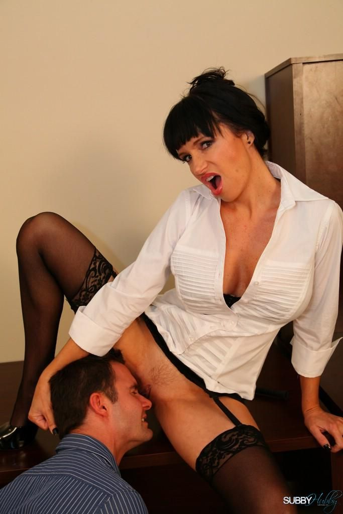 Hot brunette Angie Noir forces a submissive man to lick her pussy on his knees