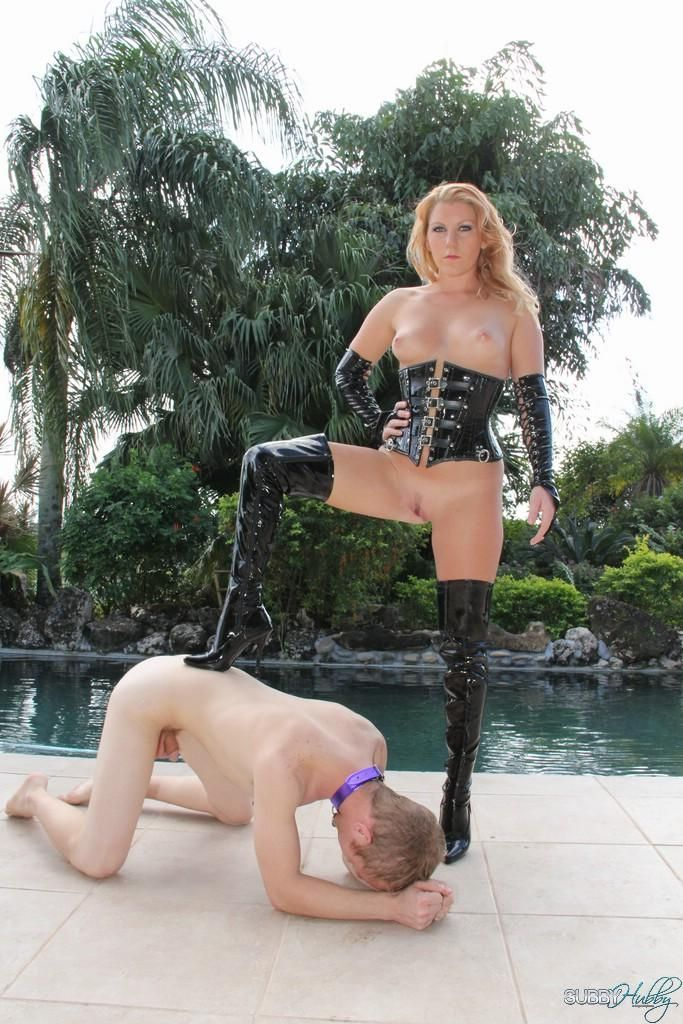 Blonde wife Ashley Edmunds dominates her sub before locking him in a cage