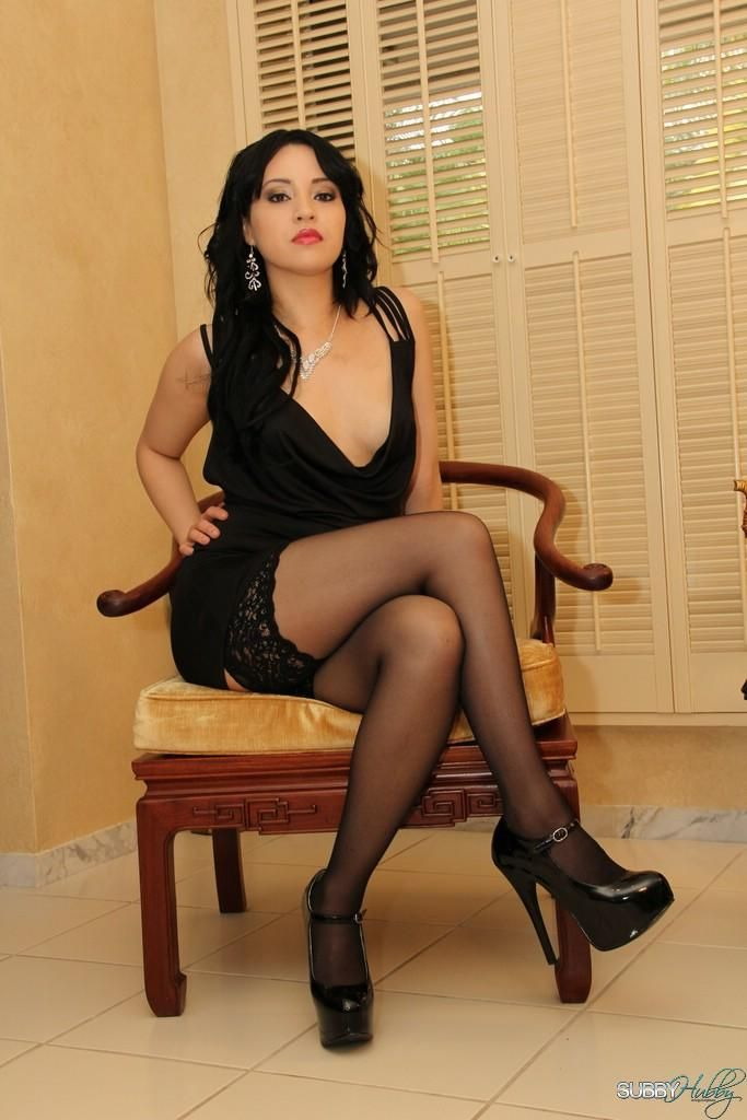 Dark haired wife Chloe Cain stomps on submissive husband in heels and nylons